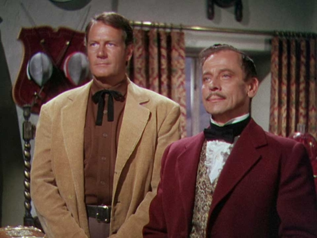 Ivan Triesault as Baron Von Hollden with Joel McCrea, Border River (1954)